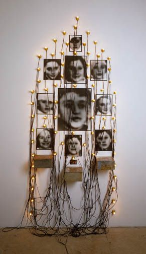 christian boltanski Monument Odessa, 1990 11 photographs, 3 tin biscuit boxes, 68 lightbulbs, glass, and electrical cords. High Museum Of Art, Atlanta, Georgia