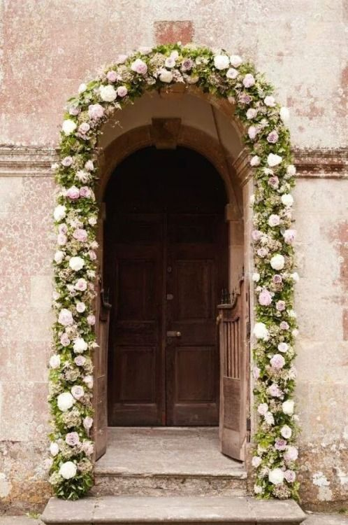 floral garland around door, creative, elegant and interesting use of flowers. #2015 #Wedding #Trend