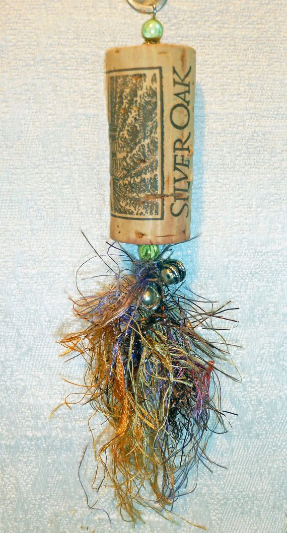 Recycled wine cork ornaments, hand made from our favorite wines. They look great hanging from a Ceiling fan/light, in a window, a gift bag,