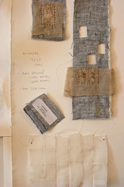 Kathryn Clark, studio wall.  Wall covered with foam core (to pin into) and then paper (to write on)