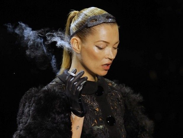 Kate Moss causes controversy by smoking on the catwalk in a creation by American fashion designer Marc Jacobs for Louis Vuitton's Fall-Winter ready-to-wear 2012 fashion collection at Paris Fashion week in 2011.