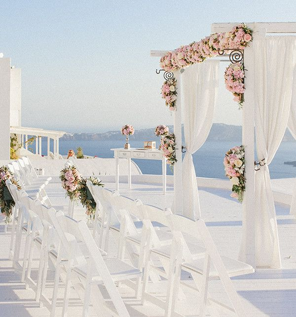 Wedding ceremony and reception  Flower design & decoration by Fabio Zardi   Bouquets, buttonholes, wedding gazebo, pew ends, registrar table centerpieces, ring box with petals, table centerpieces, lanterns, candles, tea light holders