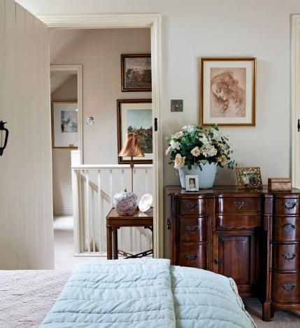 Walls are painted in Clunch by F&B. A pretty curved-front mahogony writing desk by Theodore Alexander serves as a useful dressing table. http://www.thebeautifulengland.com/beautiful-home-pictures-of-english-home-in-derbyshire/