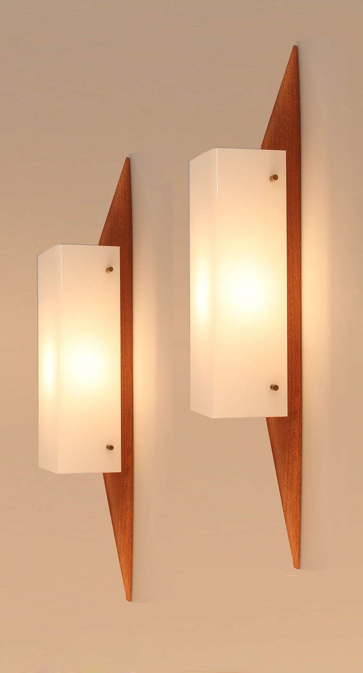 Pair of French Rispal Wall Lights Mid Century Danish Teak | From a unique collection of antique and modern wall lights and sconces at http://www.1stdibs.com/furniture/lighting/sconces-wall-lights/