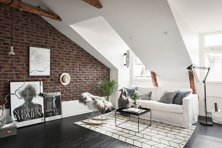 Friday is real estate day. A lot of homes hit the market on friday including this lovely attic apartment in Stockholm with exposed brick wall.