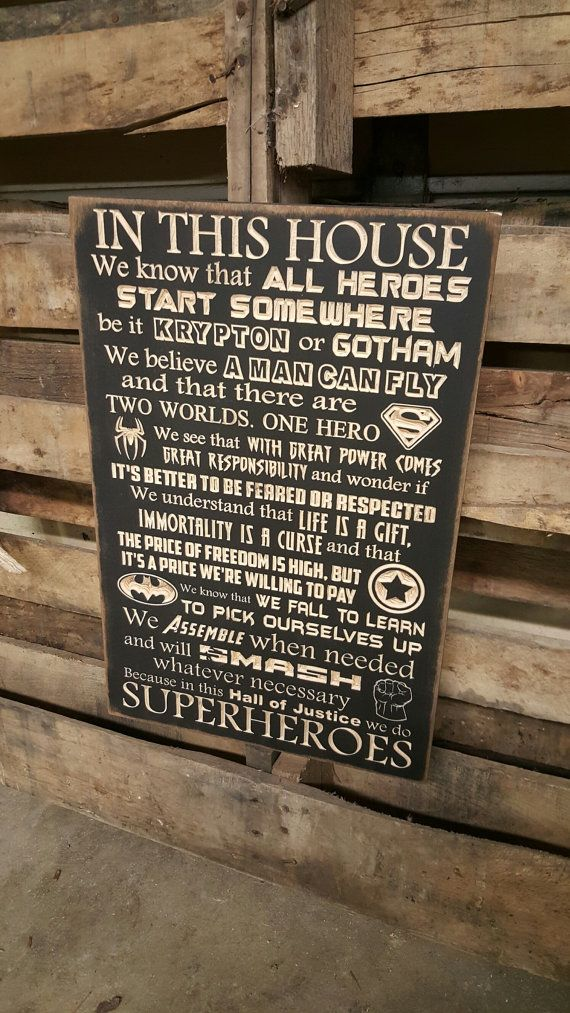 "Custom Carved Wooden Sign - ""SUPERHEROES - In this house we do - Superhero, Batman, Superman, Spiderman, Avengers, Captain America"" 20""x13"""