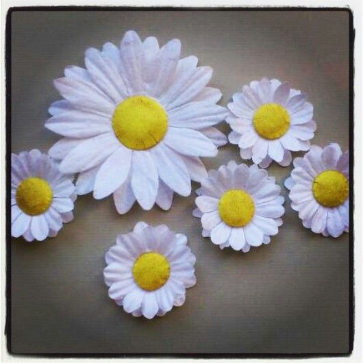 Handmade flowers, white paperflowers from docrafts with yellow paper in the middle