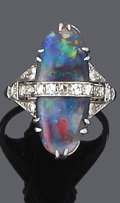 An art deco black opal and diamond ring, circa 1925 The oval-shaped cabochon black opal with central horizontal row of single-cut diamonds, to pierced graduated shoulders, diamonds approx. 0.45ct. total, ring size P