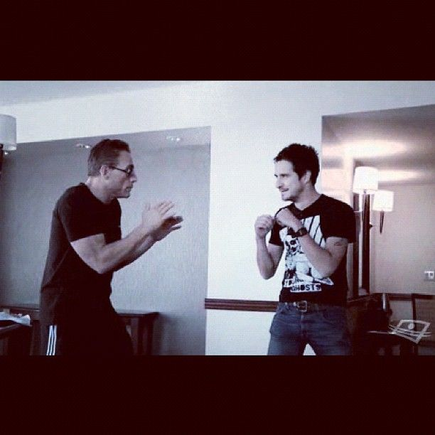 Sebastien Diaz wearing the Young Ghosts Clothing GhostBoxer Tee during an interview with Jean-Claude Van Damme