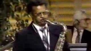 "Henry Mancini, ""Pink Panther Theme"", via YouTube. Plas Johnson on sax"