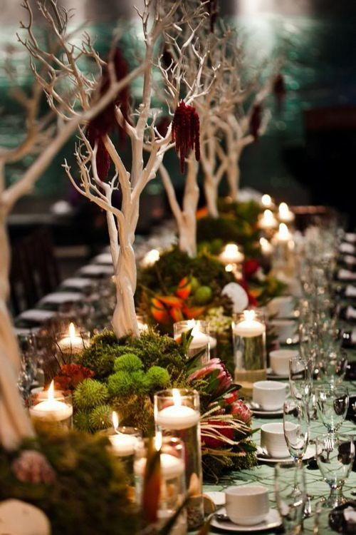 Centerpiece for a long table featuring manzanita branches, greenery, flowers, and candles. I love these colors! Definitely my wedding colors