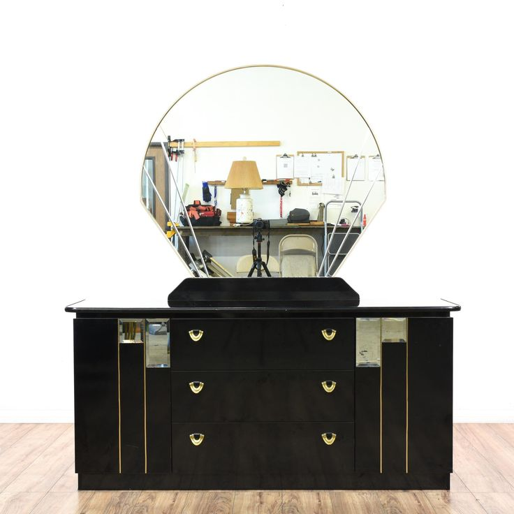 This contemporary art deco vanity dresser is featured in a solid wood with a glossy black lacquered finish. This long dresser has a curved top mirror with 3 drawers and side cabinets. Stunning and sleek storage piece perfect for a spacious bedroom!  #contemporary #dressers #vanitydresser #sandiegovintage #vintagefurniture