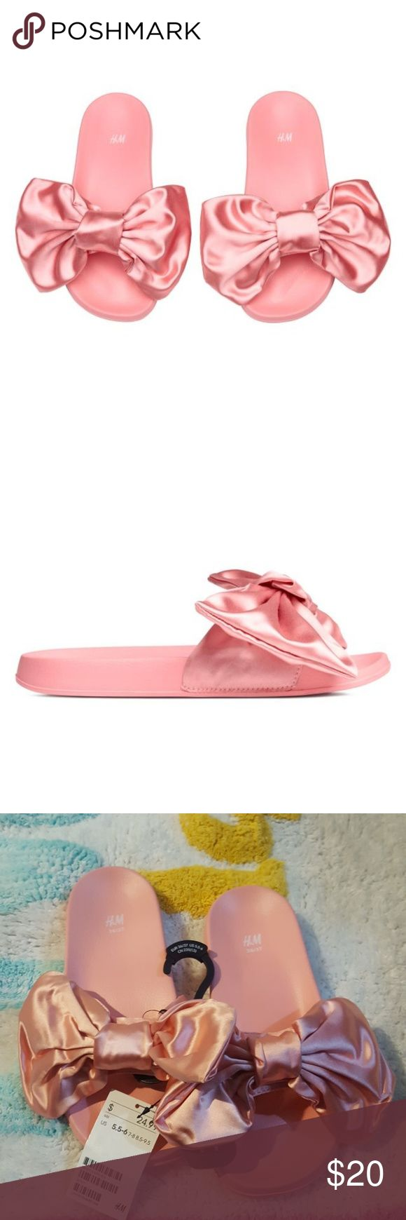 """H&M Slippers in satin Slippers in satin and plastic with a large bow at the front and embossed soles.  """"Keep away from fire. The items shown with this symbol are not required to comply with flammability performance requirements of """"""""The Nightwear Safety Regulations 1987"""""""" and have therefore not been tested to those requirements.""""  COMPOSITIONLining and sock: Polyester 100%Outer sole: Ethylene Vinyl Acetate 100%Upper: Polyester 100% H&M Shoes Slippers"""