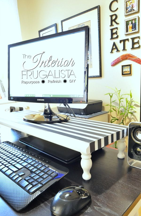 An easy DIY Computer Monitor Stand with funky black and white stripes.
