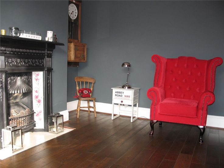 an image from farrow and ball dark grey wall with red accent colour
