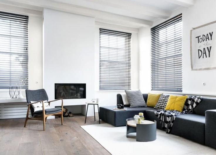 Fabric blinds, like these charcoal gray butterfly blinds, work beautifully in #Contemporary Room settings. Our fabric blinds, created exclusively for #BudgetBlinds, feature durable, easy-care, fabrics in the latest colors and unique weaves that are as practical as they are beautiful.