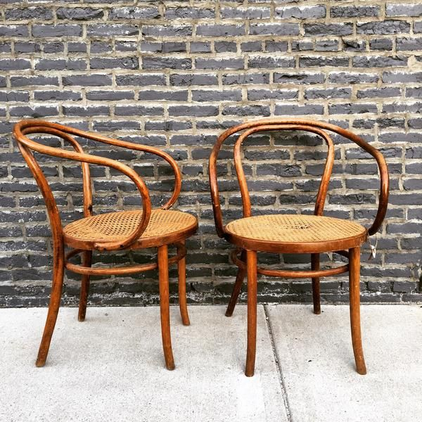Pair of beautiful, vintage Thonet cane chairs. Seats need to be re-caned or to have a slip seat made. These chairs are sculptural and will add…