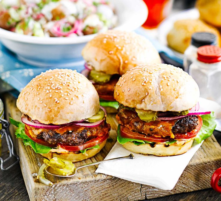 These diner-style sliders have gooey melted cheese and all the fixings - the ultimate American beef burgers for a barbecue feast