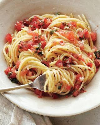 Pasta with Fresh Tomatoes, Basil, Parsley, Garlic, Olive Oil, Salt/Pepper & Parmesan Cheese... This would be to die for with grilled chicken in it!!