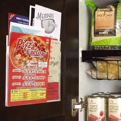 Because they come in many sizes and shapes, to-go menus can be the bane of a junk drawer's existence. The answer? Move the take-out department to the inside of a cabinet door. A wall-mounted acrylic brochure holder, available at any office supply store, will do the trick nicely.