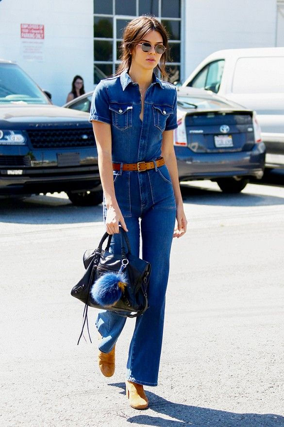 Kendall Jenner wears a Le Mechanic Flare Jumpsuit with a Balenciaga bag and Gianvito Rossi boots.