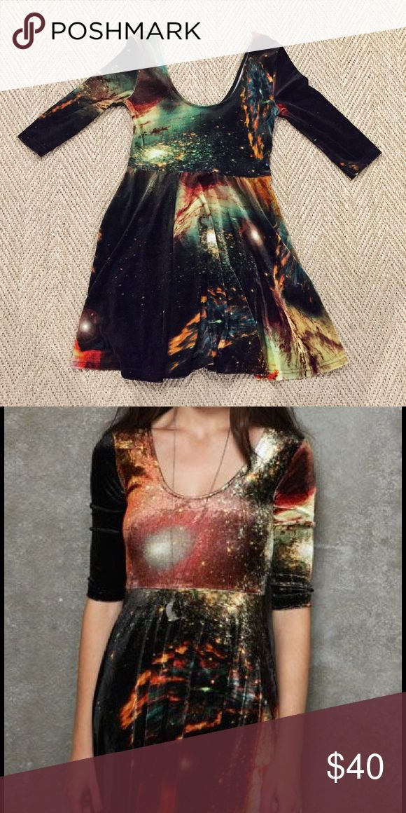 Evil Twin Space Galaxy Dress Evil Twin galaxy dress! Only worn once. This dress features a super cool galaxy print, in a soft velvet material. Girl in dress is wearing different pattern, but same concept and company. evil twin Dresses Midi