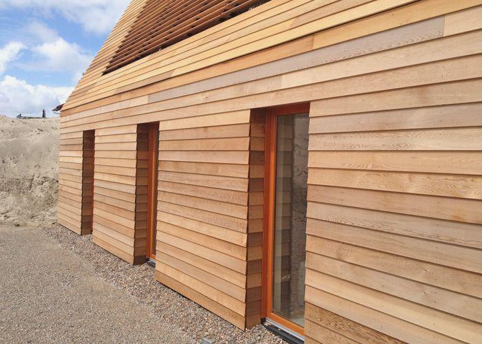 Detail of wooden facade of a  private house between the dunes. Terschelling, the Netherlands. By AchterboschZantman architecten.