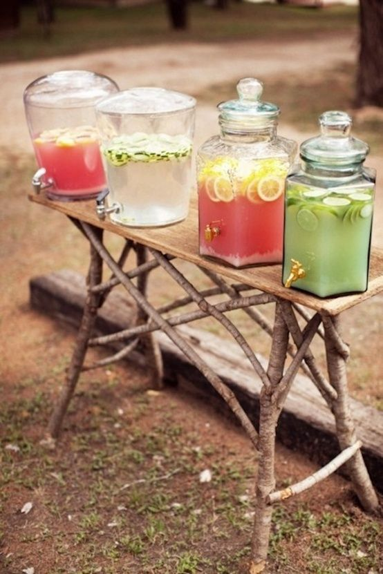 Drink station on a picnic table...want to do this with some wedding day 'signature' drinks.