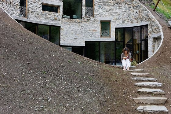 wouldn't it be nice to live in a cave? a modern cave in a mountain?  (house by Search & Christian Muller Architects)