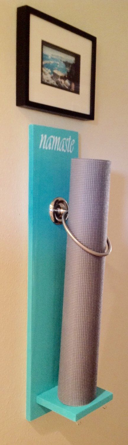 Wall Mounted Yoga Mat Holder: I'm not at all crafty, but even I could make one of these!