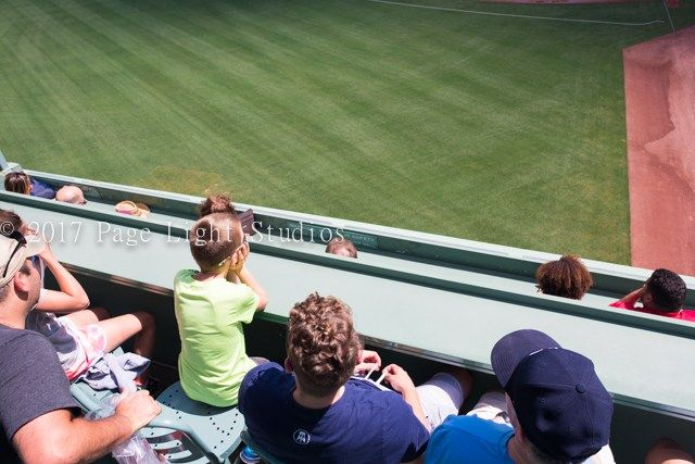 Boston Lifestyle Photography: I imagine this boy wishes he were sitting in this awesome 'Green Monster' VIP seat at Fenway Park during an actual Red Sox game, not during a guided tour. Ah, dreams. With love, ~Page L…