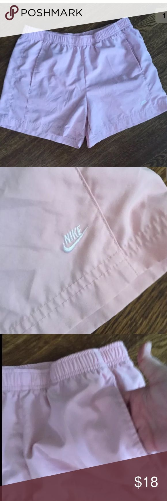 Vintage Pink Nike Running Shorts Size Small Nike brand pink workout shorts with pockets in a ladies size small. Shorts have been kept smoke free and are in excellent condition.  We love to bundle and combine shipping so shoot us offers! Nike Shorts