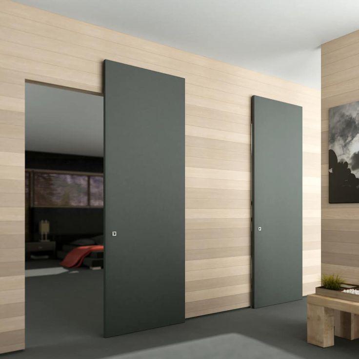 Scorrevole esterno muro senza binario a vista : Finestre & Porte in stile in stile Minimalista di Phi Phorte