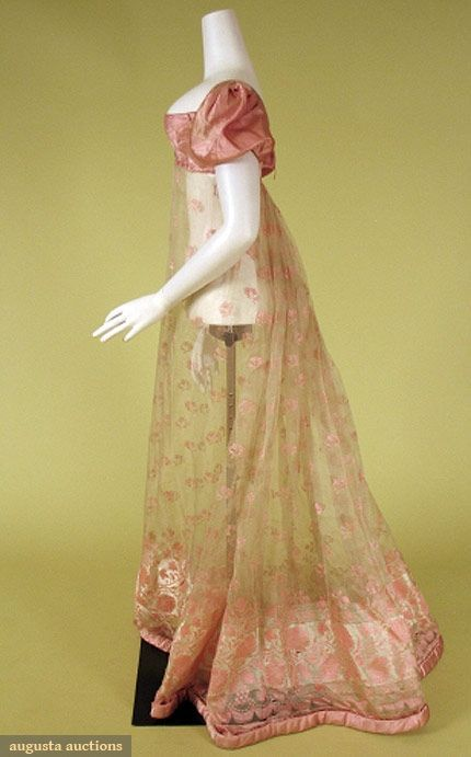 """Pink and cream silk gauze dress, 1800-10. August Auctions: """"Pink silk satin Empire bodice and short, puffed sleeves, skirt of cream leno weave gauze brocaded with pink flowers woven en disposition with dense floral design at hem, square neckline and two drawstrings at back, slim skirt with center back gathers, padded satin rouleau hem"""""""