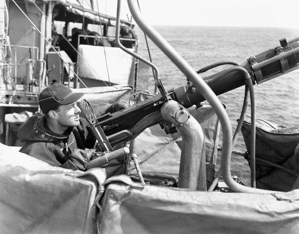 Rating manning a .50-calibre machine gun aboard H.M.C.S. ST CROIX at sea, March 1941.