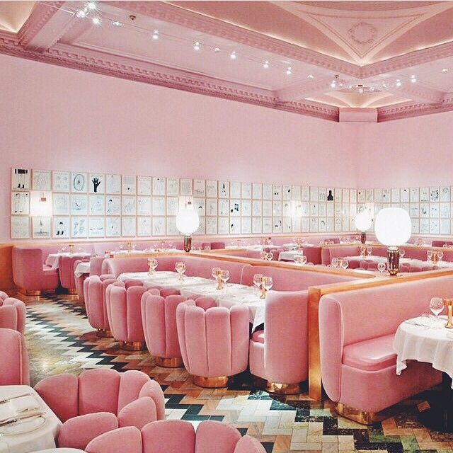 The Pink Gallery at Sketch in London // pink dining room with retro chairs and chevron floors