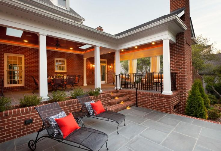 A truly magnificent outdoor living area with covered patio, wood burning fireplace, open patio, built In planter and accent lighting. Designed by Advanced Renovations