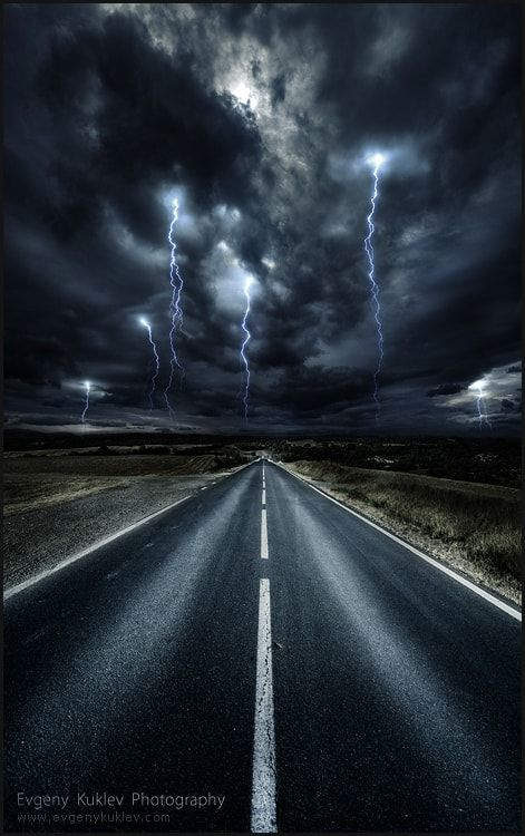 Into the storm on a lonely road (no location given) by Evgeny Kuklev / 500px