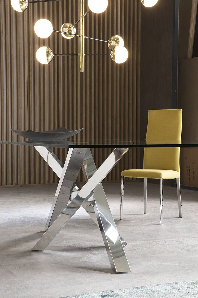 Table SHANGAI: table with alluminium base composed by legs tilted and overlapped in asymmetric way, with central junction.  Chair DENISE: chair with steel frame upholstered. Sharped and ergonomic seatback. Available in: eco-leather, eco-nabuk, leather