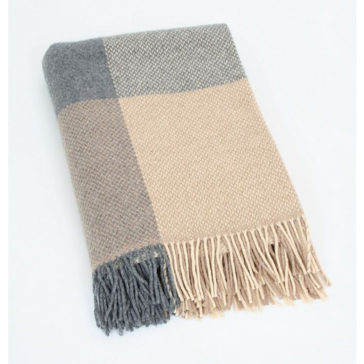 Made from 95% Merino wool and enriched with 5% finest cashmere by John_Hanly & Co., this  throw has the warm luxurious feel of cashmere.  Dimensions: 136 x 180 cms - 54 x 71 inches.