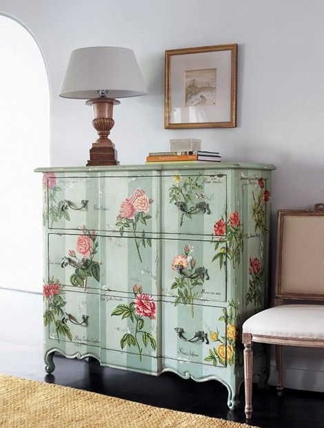 Such a pretty cabinet . . . you might be forgiven to thinking a very steady hand painted the flowers on however its actually printed paper decoupaged onto the wood.