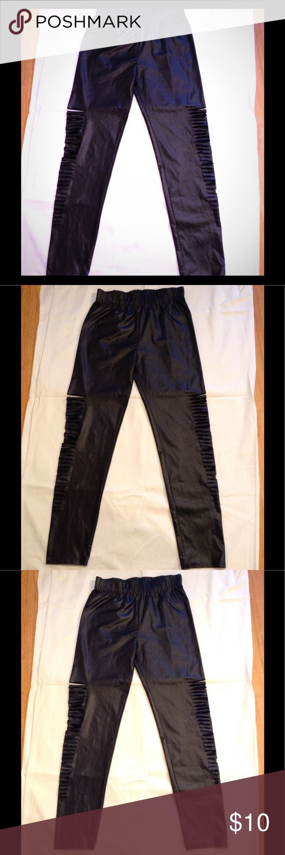 Kardashian Kollection Slash Cut Out Black Leggings Kardashian Kollection stretchy leggings with cut out slashes on the side of the legs. Size L. Worn once. First two pictures are model pictures, the other pictures are of the actual leggings you'll be receiving. Kardashian Kollection Pants Leggings