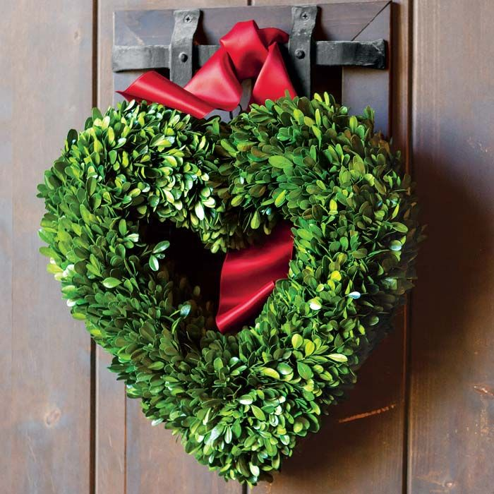 Made on a sturdy and unique heart shaped frame, this beautiful wreath of preserved boxwood adds a bit of natural simplicity to your surrounding. Hung indoors or out, wreath is best kept in a protected area and will stay green with a regular misting. Wreath measures approximately 16 in diameter and arrives adorned with a fluffy signature Olive & Cocoa® satin bow.