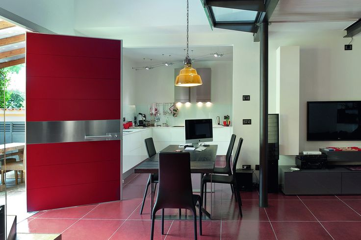 Synua door in red brick lacquered with stainless steel sector.   www.oikos.it