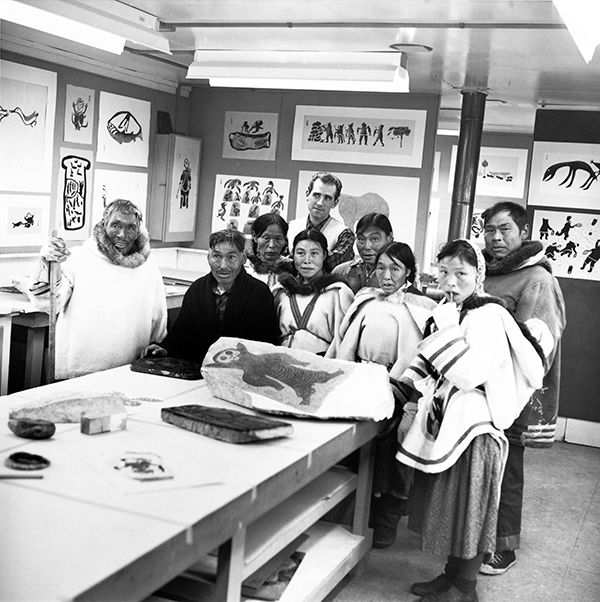 Terrance Ryan (back row) replaced the artist John Houston at the West Baffin Eskimo Co-operative, and went on to play a vital role in the printshop and the Co-op's marketing division. From left, front row: Parr, Kiakshuk, Kenojuak Ashevak, Lucy Qinnuayuak, Napachie Pootoogook; second row: Pitseolak Ashoona, Egevadluq Ragee, Pudlo Pudlat. Photograph by B. Korda.