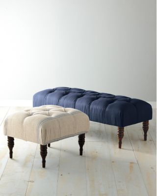 Navy tufted bench for at the end of the bed.