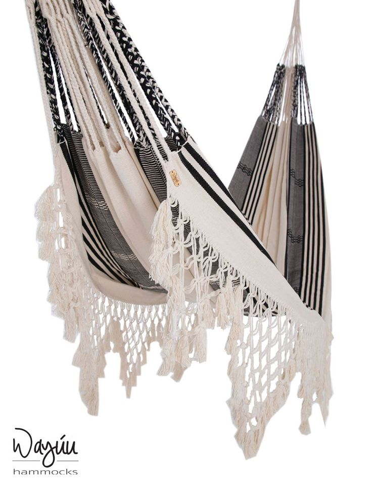 Classic. Timeless. Impressive. This black and white piece will stand out in any room without compromising a bit of style. Featuring beautifully intricate macramé detailing, this piece brings a stunning accent that provides flair and relaxation.