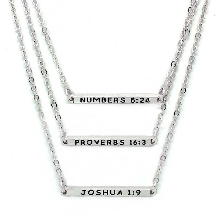 "Three strand necklace with reversible bars that are engraved with inspirational messages for the graduate.      Blessed - Numbers 6:24  Devoted - Proverbs 16:3  Wander - Joshua 1:9    Shortest strand is 16"". Matte silver plating."