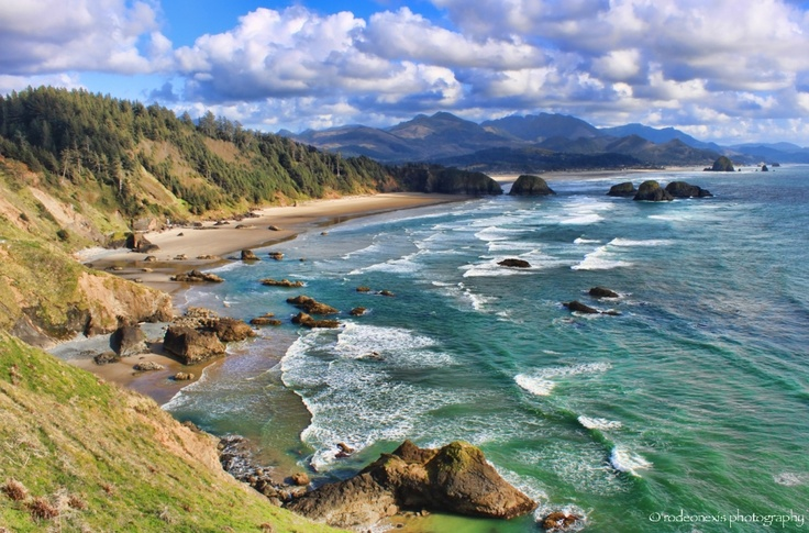 One of the most beautiful places I ever visited - Ecola State Park, Oregon and the view of Cannon Beach.   http://rodeonexis.wordpress.com/2011/05/17/fractured-shores-melt-away/