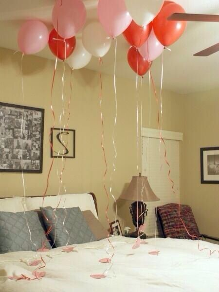 Balloons above the bed with notes of why you love him, attached to the ends. Perfect for valentines day :) I'm definitely doing this!!
